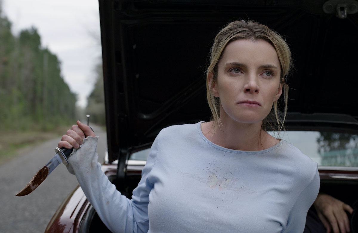 Betty Gilpin holds a bloody knife in a scene from The Hunt.