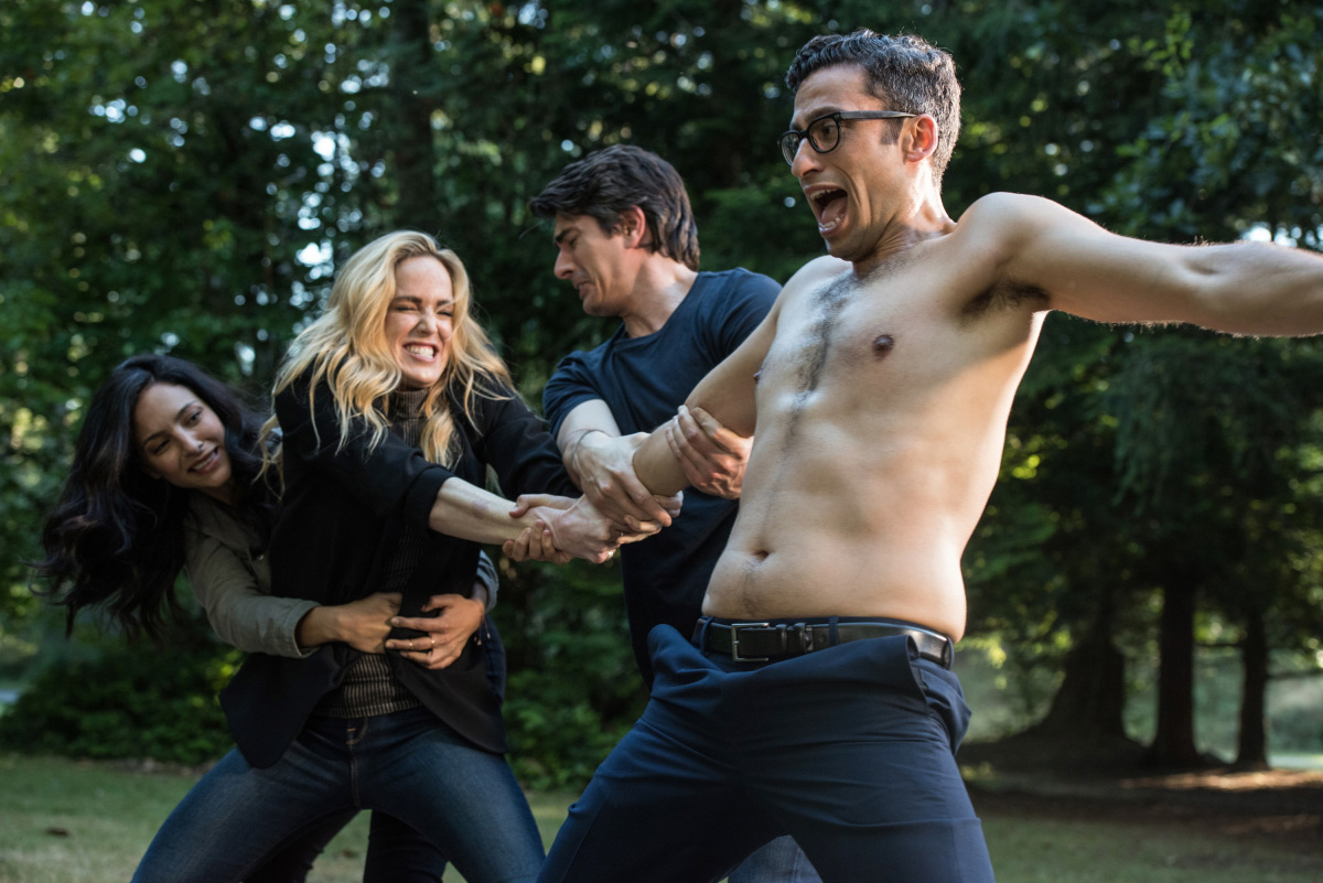 "8DC's Legends of Tomorrow -- ""The Virgin Gary"" -- Image Number: LGN401c_0385b.jpg -- Pictured (L-R): Tala Ashe as Zari, Caity Lotz as Sara Lance/White Canary, Brandon Routh as Ray Palmer/Atom and Adam Tsekhman as Agent Gary Green -- Photo: Dean Buscher/The CW -- © 2018 The CW Network, LLC. All Rights Reserved."
