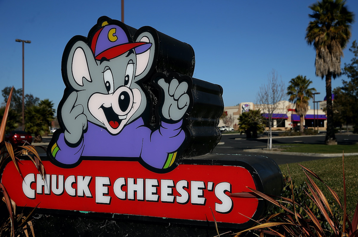 A sign for Chuck E. Cheese's.