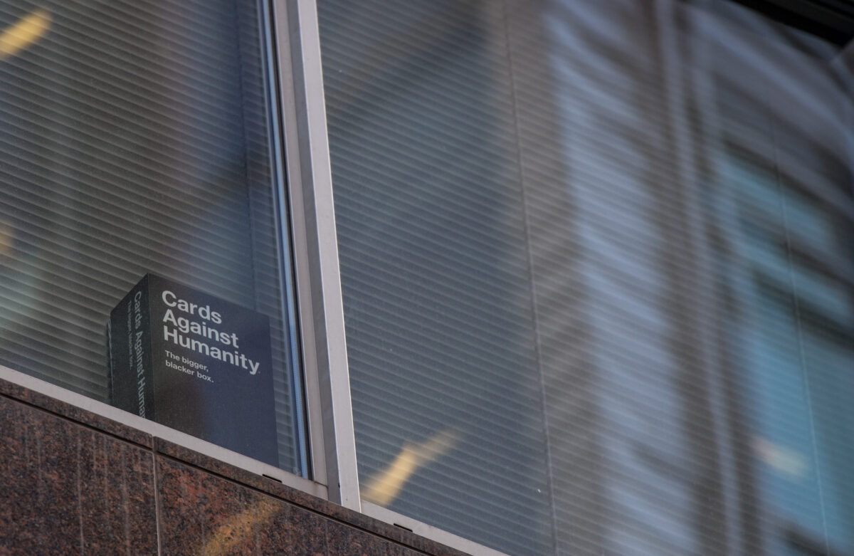 LONDON, ENGLAND - MARCH 21: A copy of the game 'Cards Against Humanity' is seen in a the window of the floor occupied by company Cambridge Analytica on March 21, 2018 in London, England. UK authorities are currently seeking a warrant to search the premises of Cambridge Analytica after the company has been involved in a row over its use of Facebook data. Their CEO Alexander Nix has since been suspended. (Photo by Chris J Ratcliffe/Getty Images)