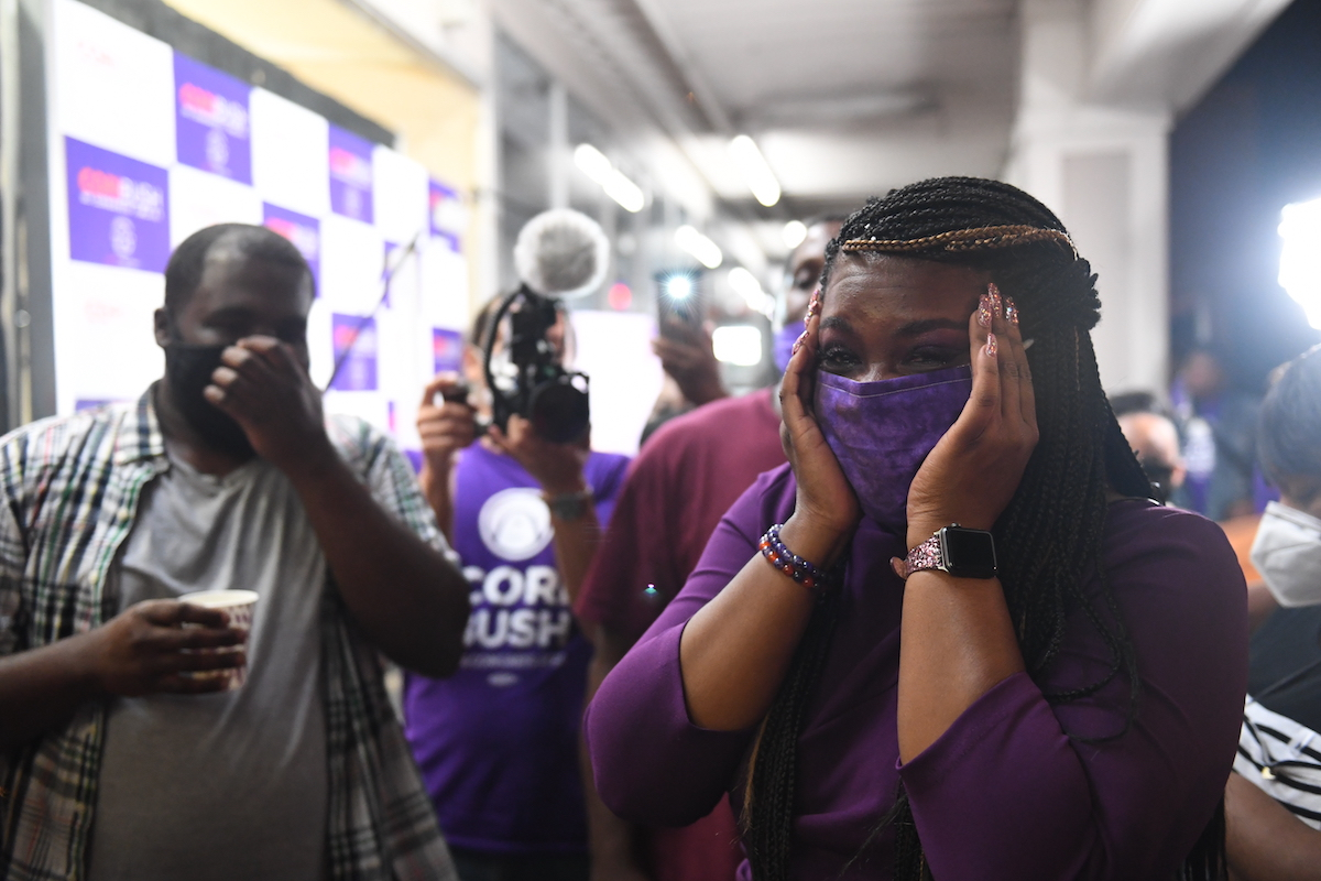 Missouri Democratic congressional candidate Cori Bush celebrates with friends and family at her campaign office