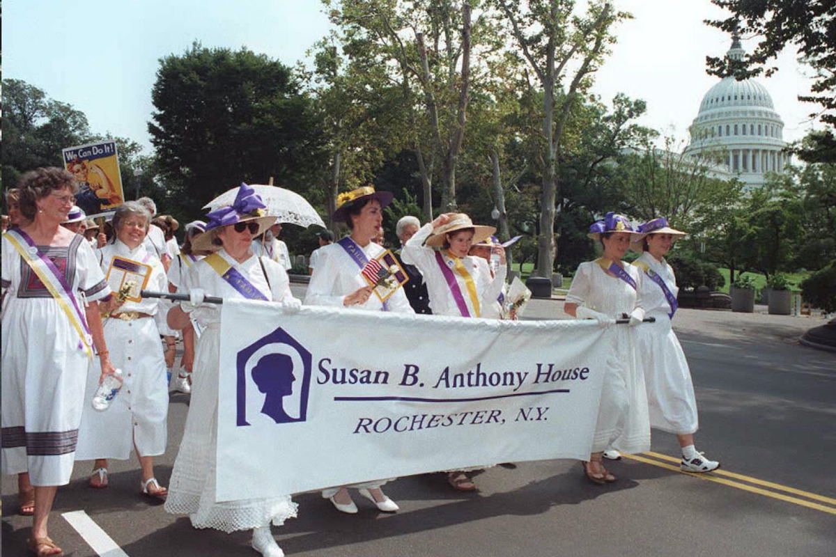 A delegation from the Susan B. Anthony House in Rochester, New York marches in the Women's Rights March