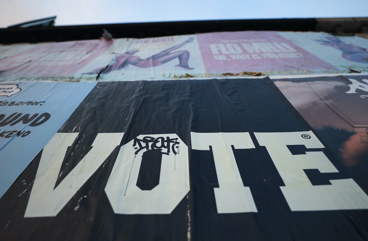 A poster reads 'Vote'