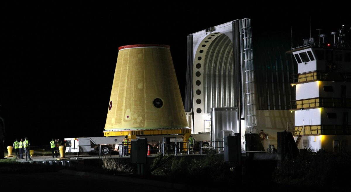 A Launch Vehicle Stage Adapter (LVSA) for the Artemis-1 mission is unloaded from a barge at Cape Canaveral Air Force Station in Florida before sunrise on July 30, 2020. - Built exclusively at NASAs Marshall Space Flight Center in Huntsville, Alabama, the three-story structure is a critical piece of the Space Launch System (SLS) rocket for the Artemis-1 mission, an uncrewed test flight which will carry the Orion spacecraft to the Moon and back in 2021. The SLS rocket will also carry 13 small satellites that will perform their own science and technology investigations. (Photo by Gregg Newton / Gregg Newton / AFP) (Photo by GREGG NEWTON/Gregg Newton/AFP via Getty Images)