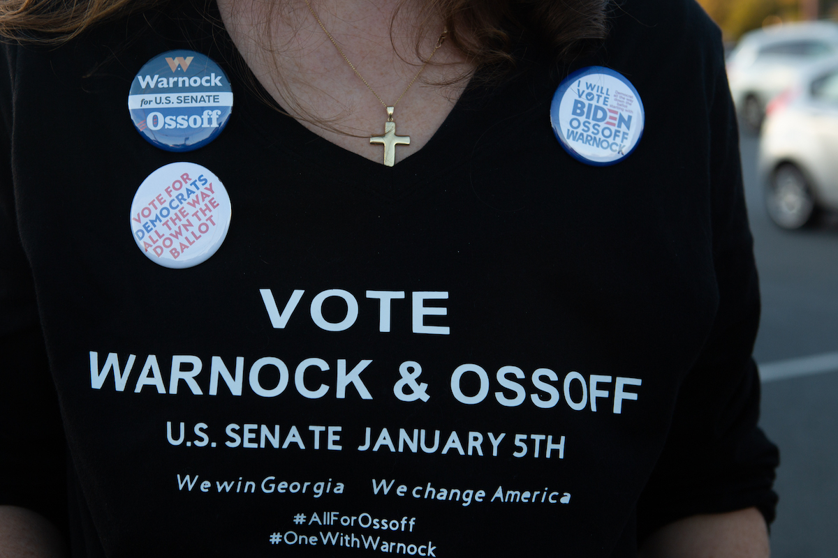 A supporter wears a homemade T-shirt to promote Democratic U.S. Senate candidates Jon Ossoff and Raphael Warnock of Georgia