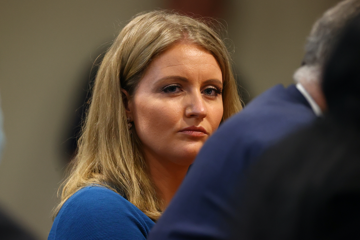 Jenna Ellis, a member of U.S. President Donald Trump's legal team, listens to Detroit poll worker Jessi Jacobs during an appearance before the Michigan House Oversight Committee