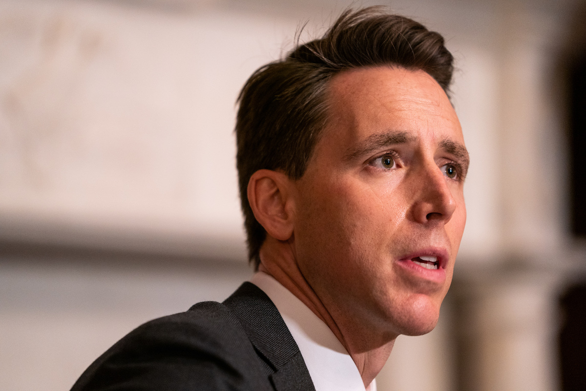 Josh Hawley looks on with his stupid face.