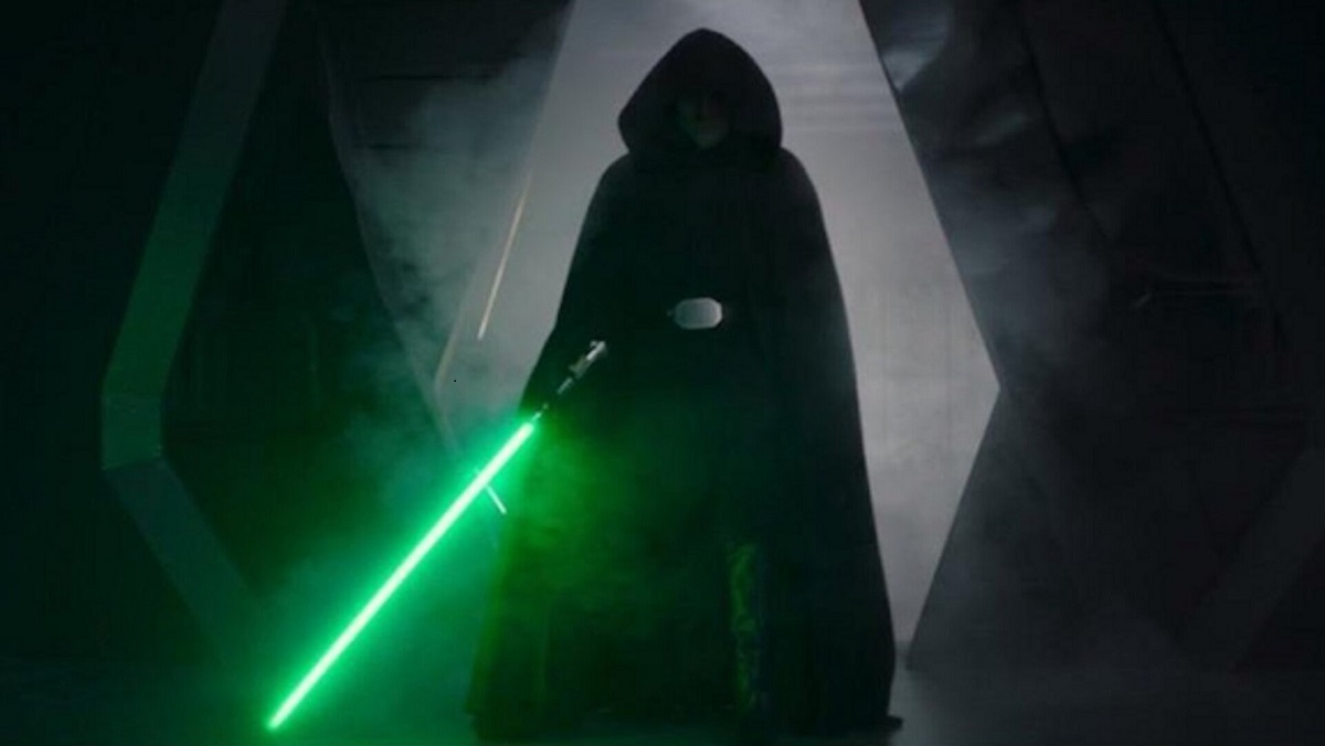 """Luke Skywalker holding his lightsaber, on his way to save Grogu in The Mandalorian's """"The Rescue"""" on Disney+."""