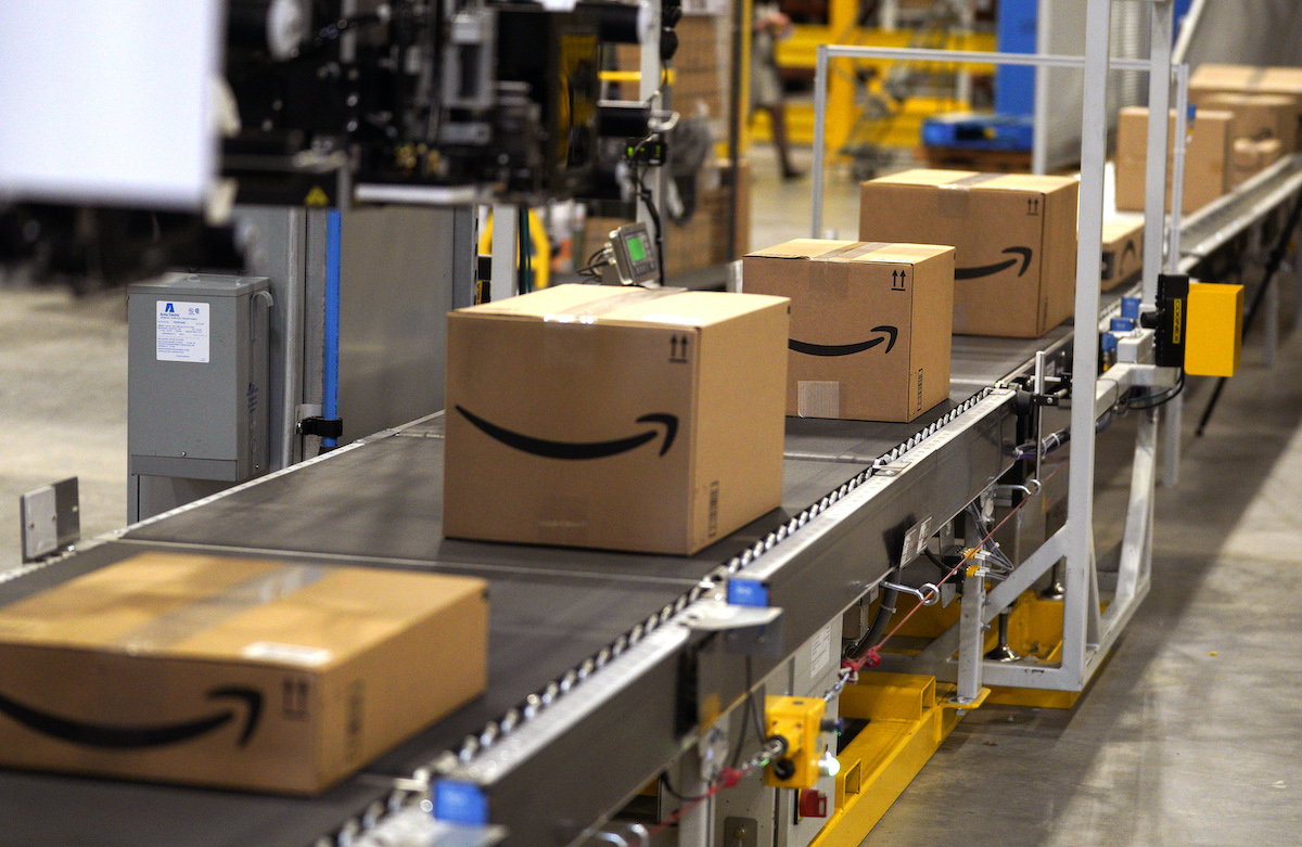 Packed orders move down a converyor belt at the Amazon fullfillment center
