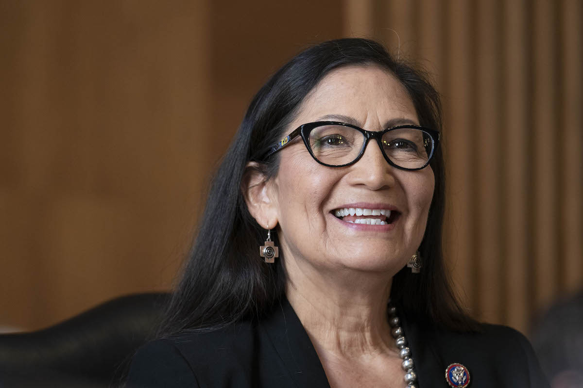 Rep. Deb Haaland (D-NM), nominee for Secretary of the Interior, grins during her confirmation hearing