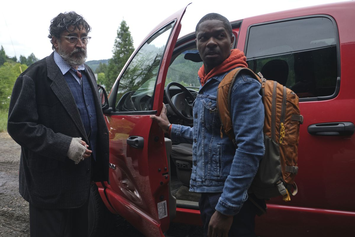 Alfred Molina and David Oyelowo stand next to a truck in the Water Man