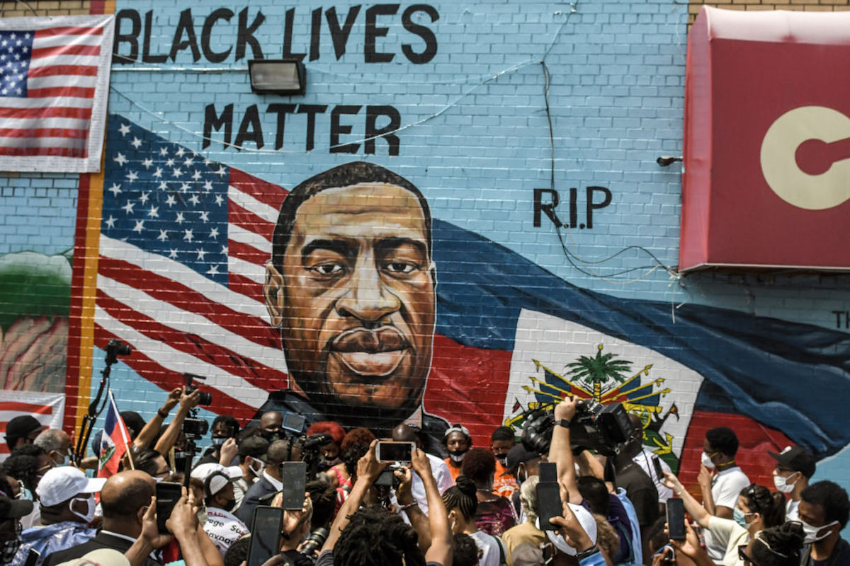 A colorful mural painted in memory of George Floyd by artist Kenny Altidor