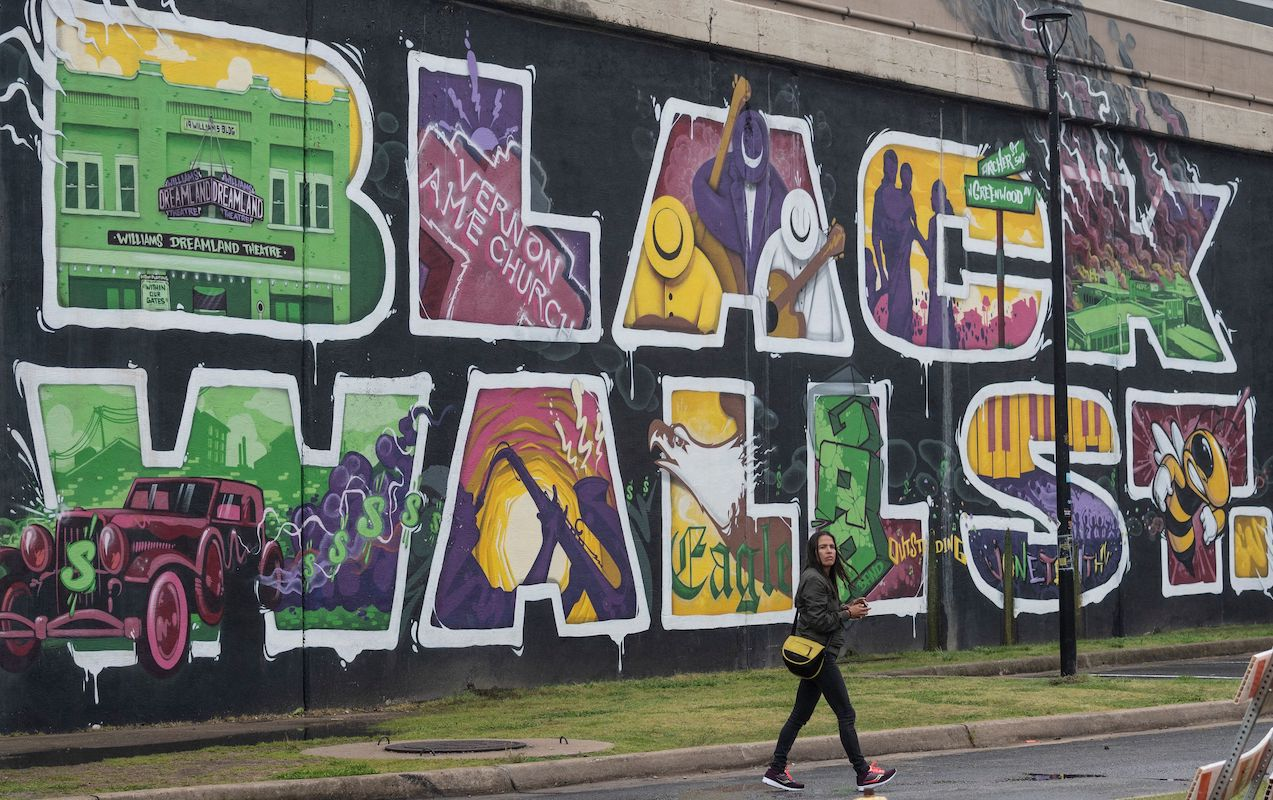 """A mural in Tulsa, Oklahoma reads """"Black Wall St"""""""