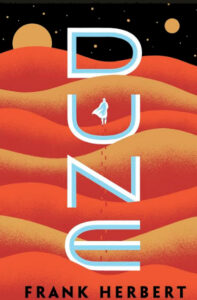 """Cover of Frank Herbert's """"Dune"""" with man walking through sand dunes. (Image: Ace Books)"""