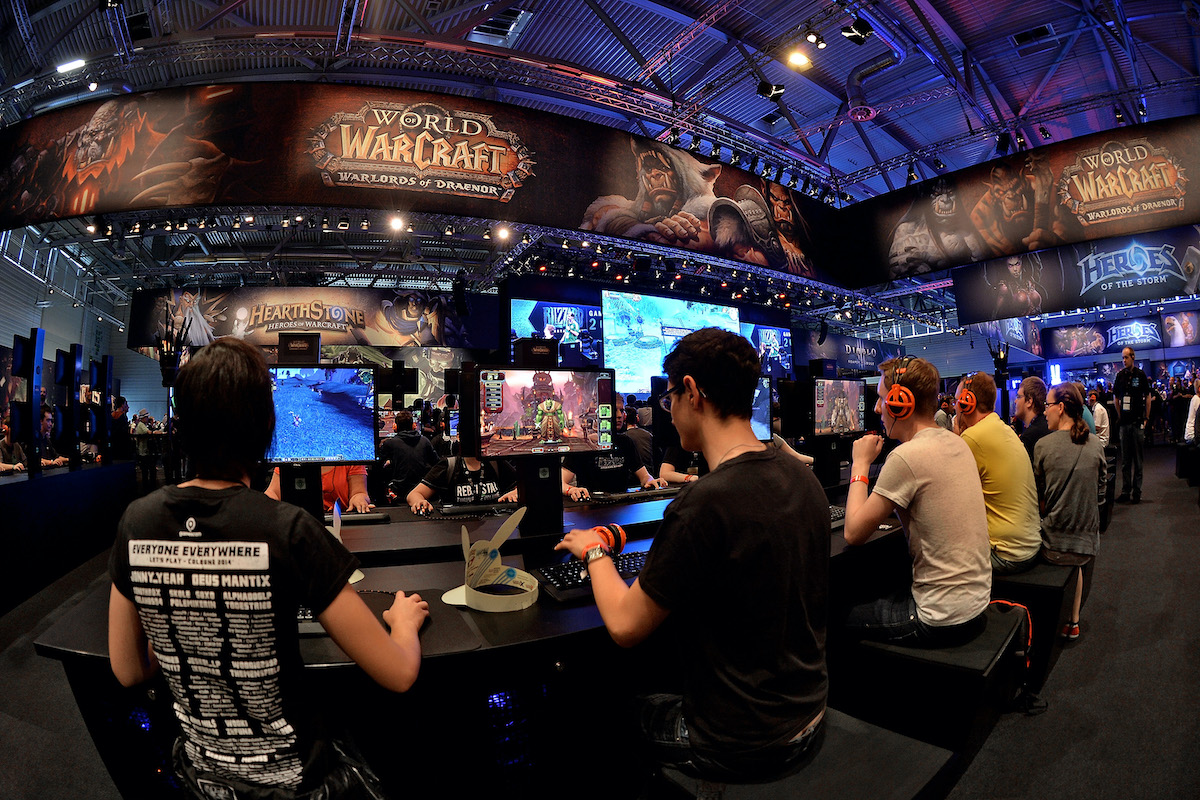 Visitors play World of Warcraft at a video game trade fair