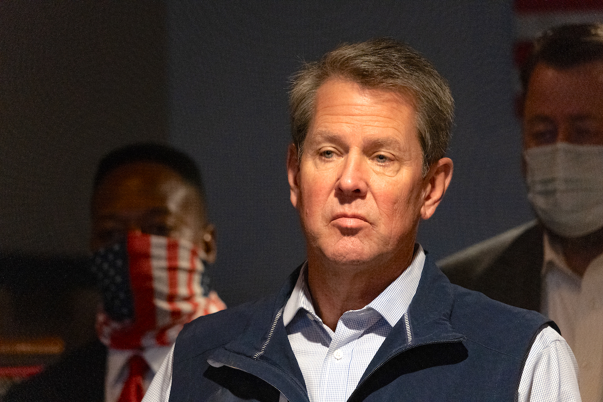 Brian Kemp speaks at a news conference