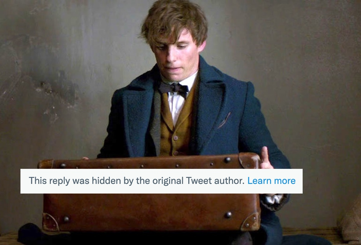 Eddie Redmayne as Newt Scamander in 'Fantastic Beasts and Where to Find Them' looks at a suitcase. A text box is superimposed about hidden replies on twitter.