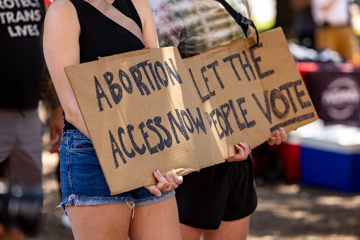 A woman carries a sign calling for access to abortion at a rally at the Texas State Capitol
