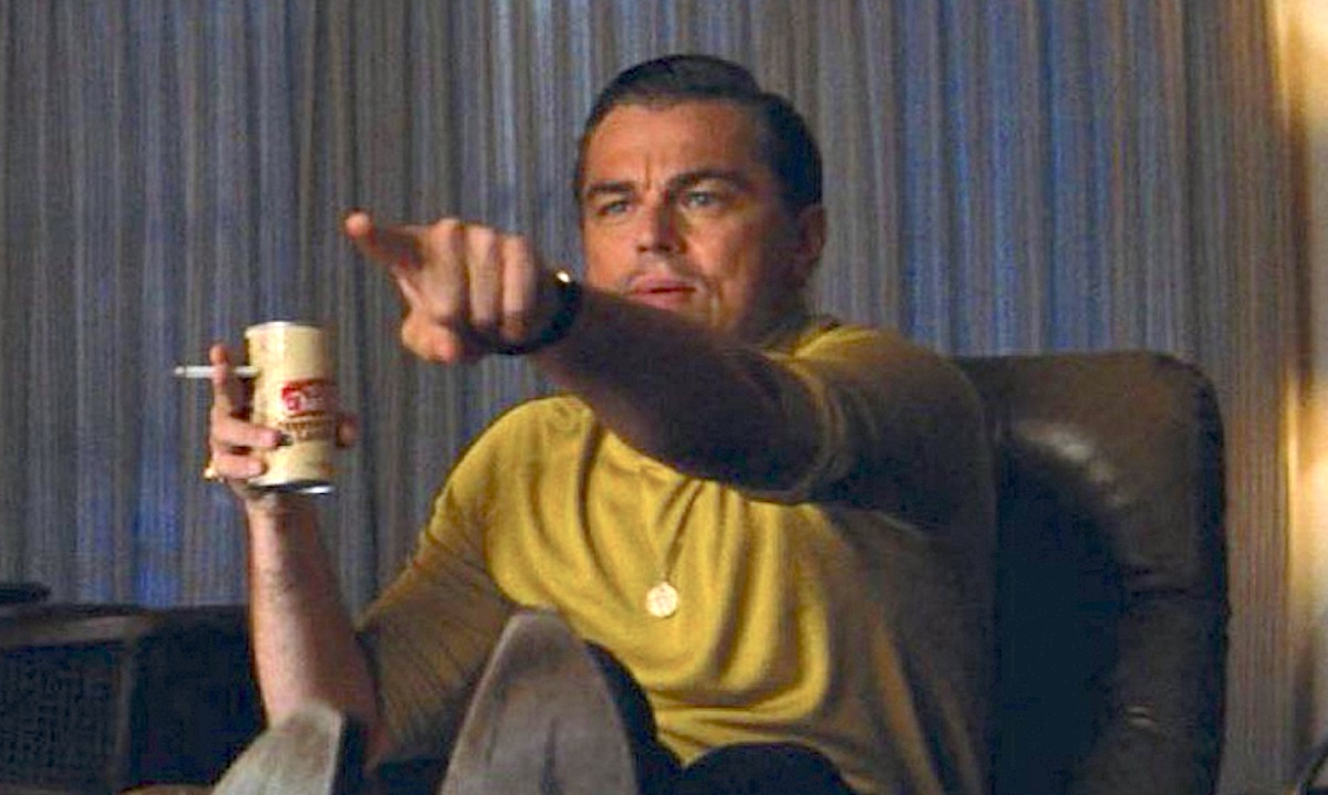 Leonardo DiCaprio in a yellow shirt pointing as Rick Dalton in the movie 'Once Upon a TIme in Hollywood'
